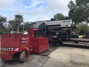 pedowitz-machinery-movers-south-florida-moving-an-amada-turret-punch-press-1.jpg